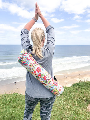 yoga mat bag over the shoulder on person