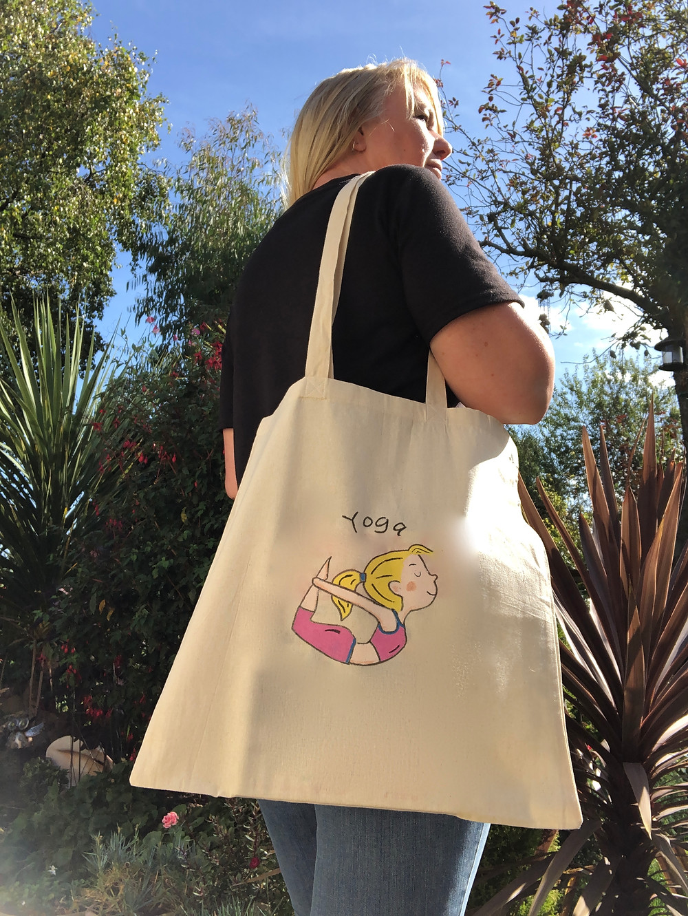 yoga tote bag featuring bow pose