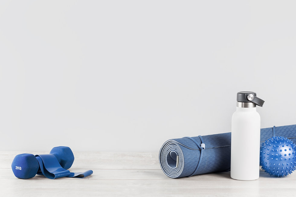 Rolled blue yoga mat and white metal wat
