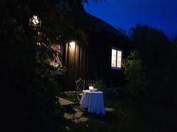 Thimber house at night