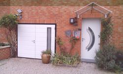 Porte de garage isolée à deux battants MOOS ANSTAING