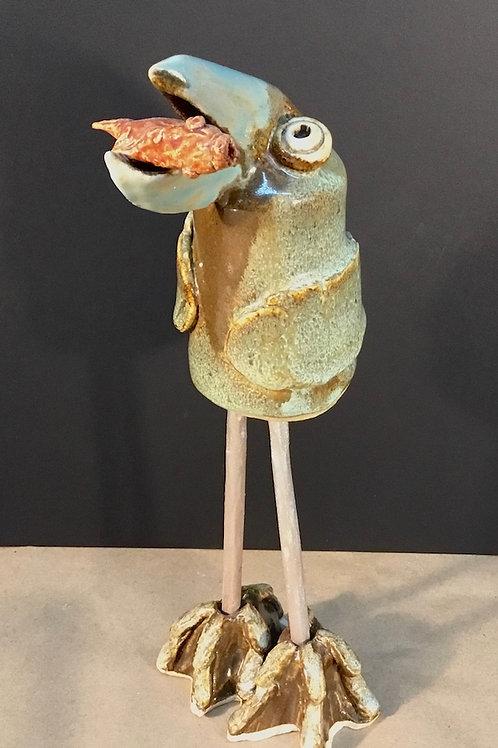 Ceramic shorebird with fish by artist Janie Friedland