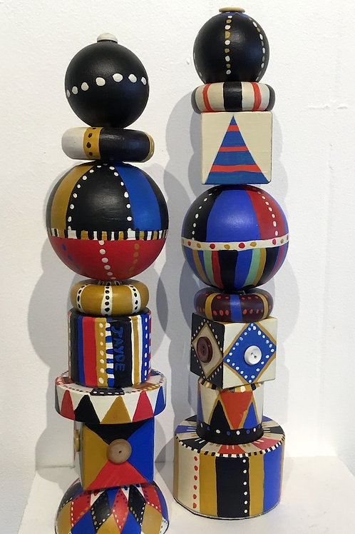 Pair of wood totems by artist Jayde Archbold
