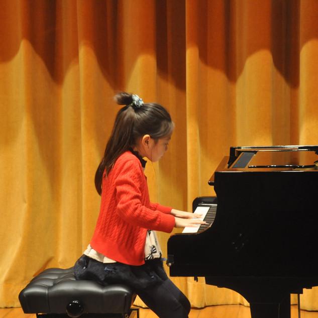 Alvina performing