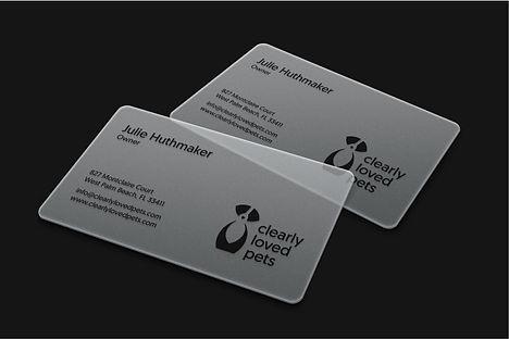 Transparent business card with black dog logo design.