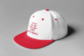 Red logo on a white baseball cap with red visor.