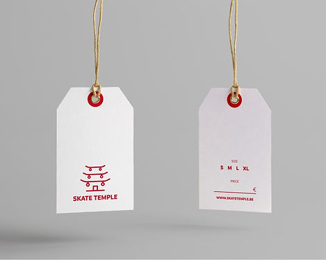 Red and white hang tags depicting Skate Temple logo and available sizes of merchandise.