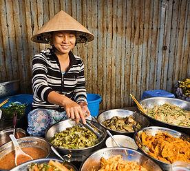 Vietnamese%20girl%20selling%20food_edite