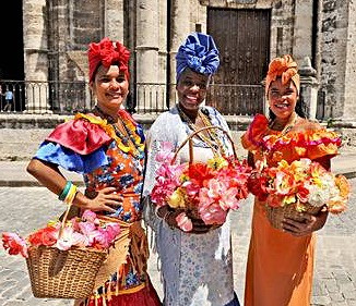 25693456-havana-cuba-may-6-2009-three-cuban-women-in-traditional-dresses-in-havana-cuba-on-may-6th-2009-_edited.jpg