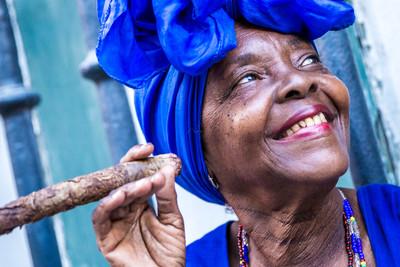 Portrait of african cuban woman smoking cigar in Havana, Cuba.jpg