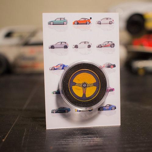 NRG Ryan litteral steering wheel coin