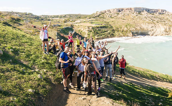 group of people with travel agency in malta