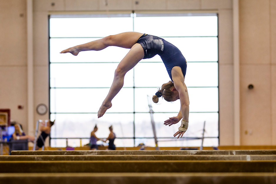 Sophomore Lauren Farley flips as part of her beam routine during practice in February. Her beam routine is one of her highest scoring events in her career at Michigan so far.