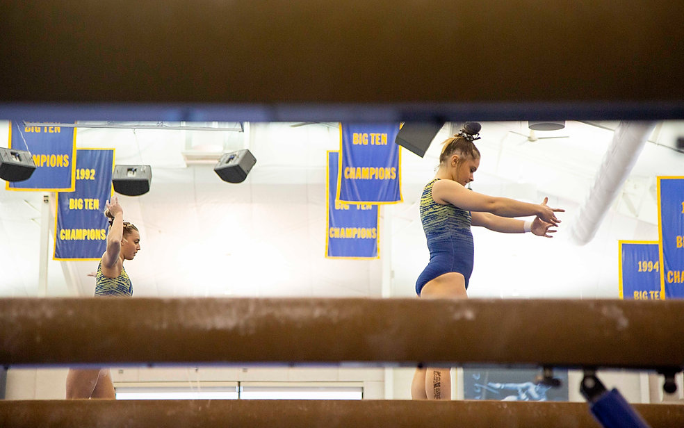 Junior Maddy Osman prepares for her beam sequence during the teams' practice for their intersquad meet. In the team's beam rotation, she is the only one to complete the dismount to the side of the beam.