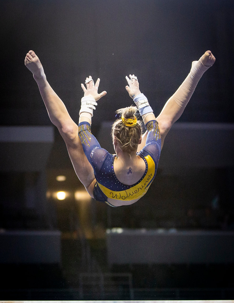 Freshman Abby Brenner flips during her uneven bars routine at the Elevate the Stage meet, where the entire team scored 9.900 or higher, the second highest combined score in program history.