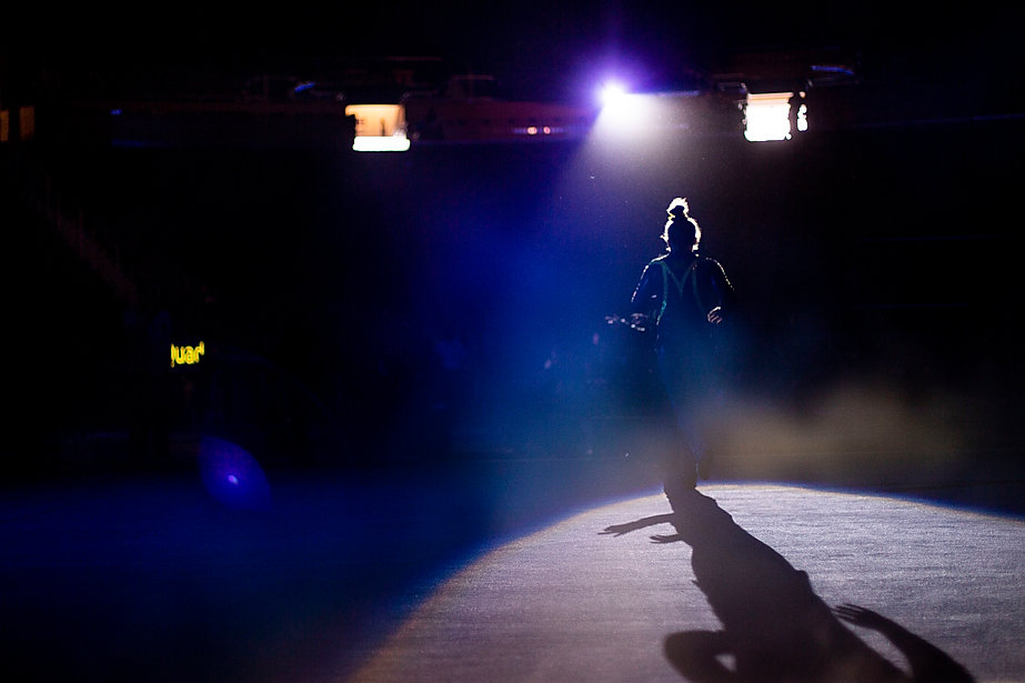A gymnast runs out of the tunnel for introductions before an exhibition against Central Michigan, Eastern Michigan, and Western Michigan at Crisler Center on December 2nd, 2018.