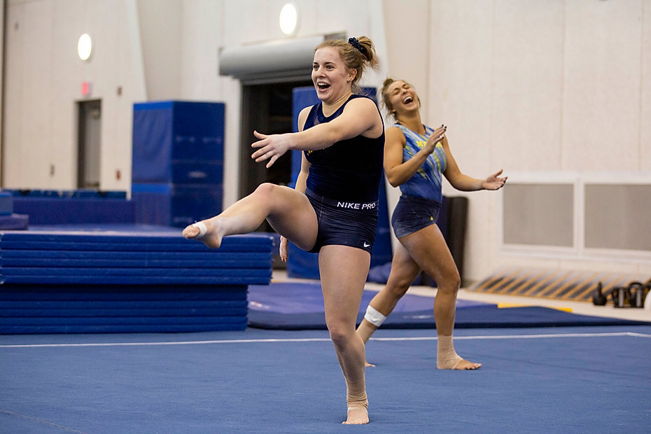 Freshman Abby Heiskell makes senior Olivia Karas laugh during the dancing portion of her floor routine during practice before the season started.