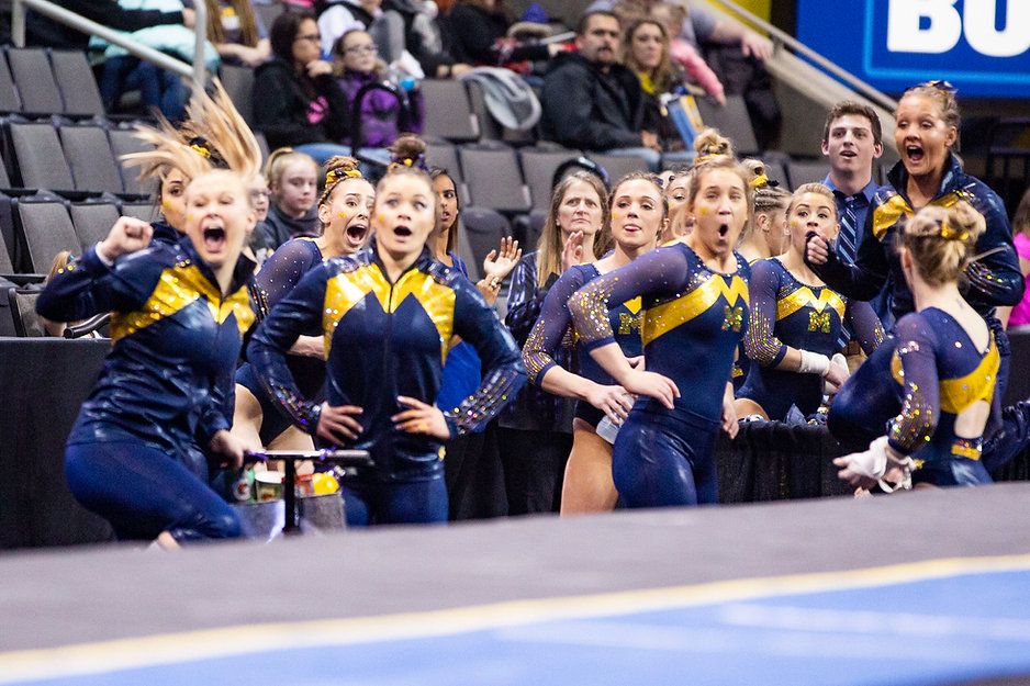 The team's reaction to freshman Natalie Wojcik's perfect 10 score on her vault routine at the Elevate the Stage meet. It was her first 10 of the season, having received a 9.975 twice before, just short of perfect. She is third in the nation on vault.