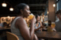 Canva - Person Drinking Beverage While S