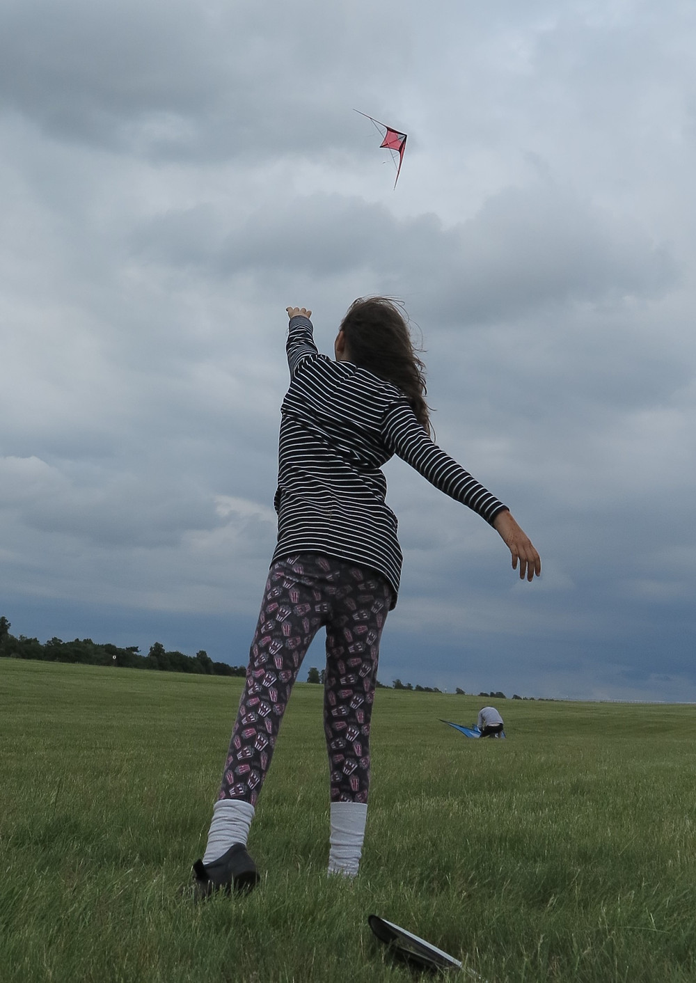 Bethany in action...having just thrown a kite up