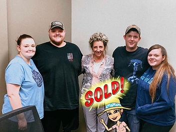 Realtor Michelle Childress with clients at a closing of their home.