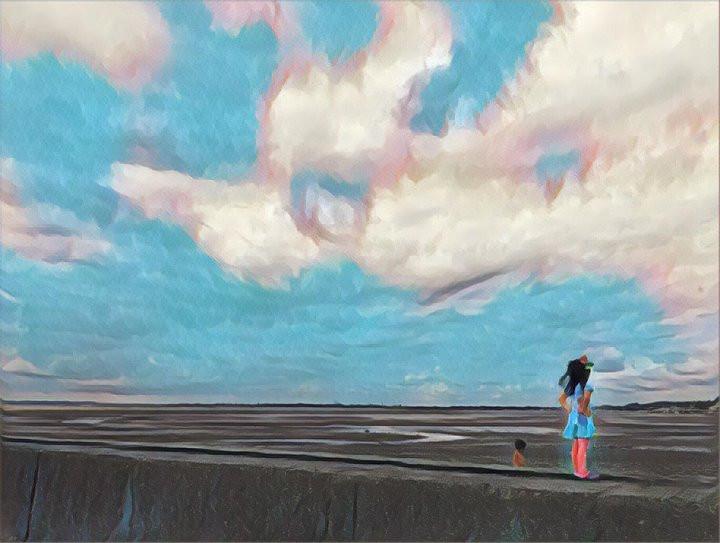 Girl on London beach in low tide