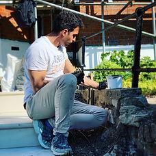 Painter crouching