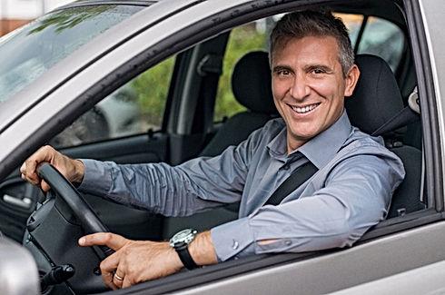 Man at wheel of car