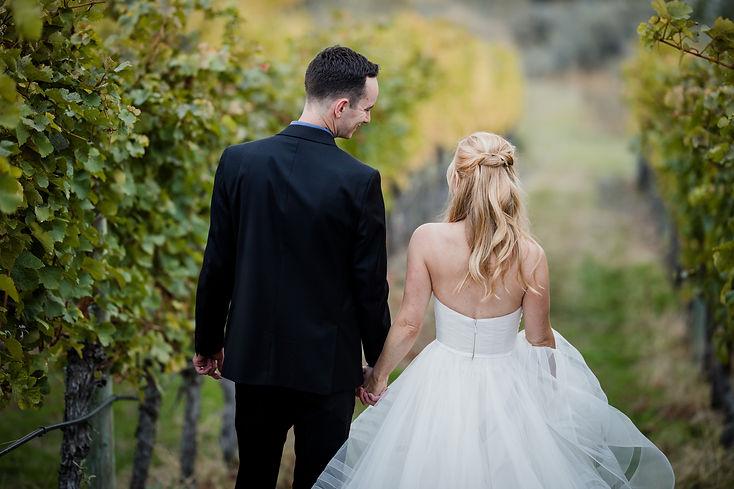 Bride and groom walking in winery