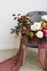 Beautiful flowers and linen on chair