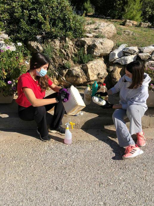 Ines and Margarita cleaning plastics