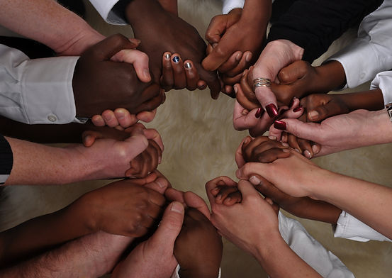 A bunch of different hands in a circle.jpg