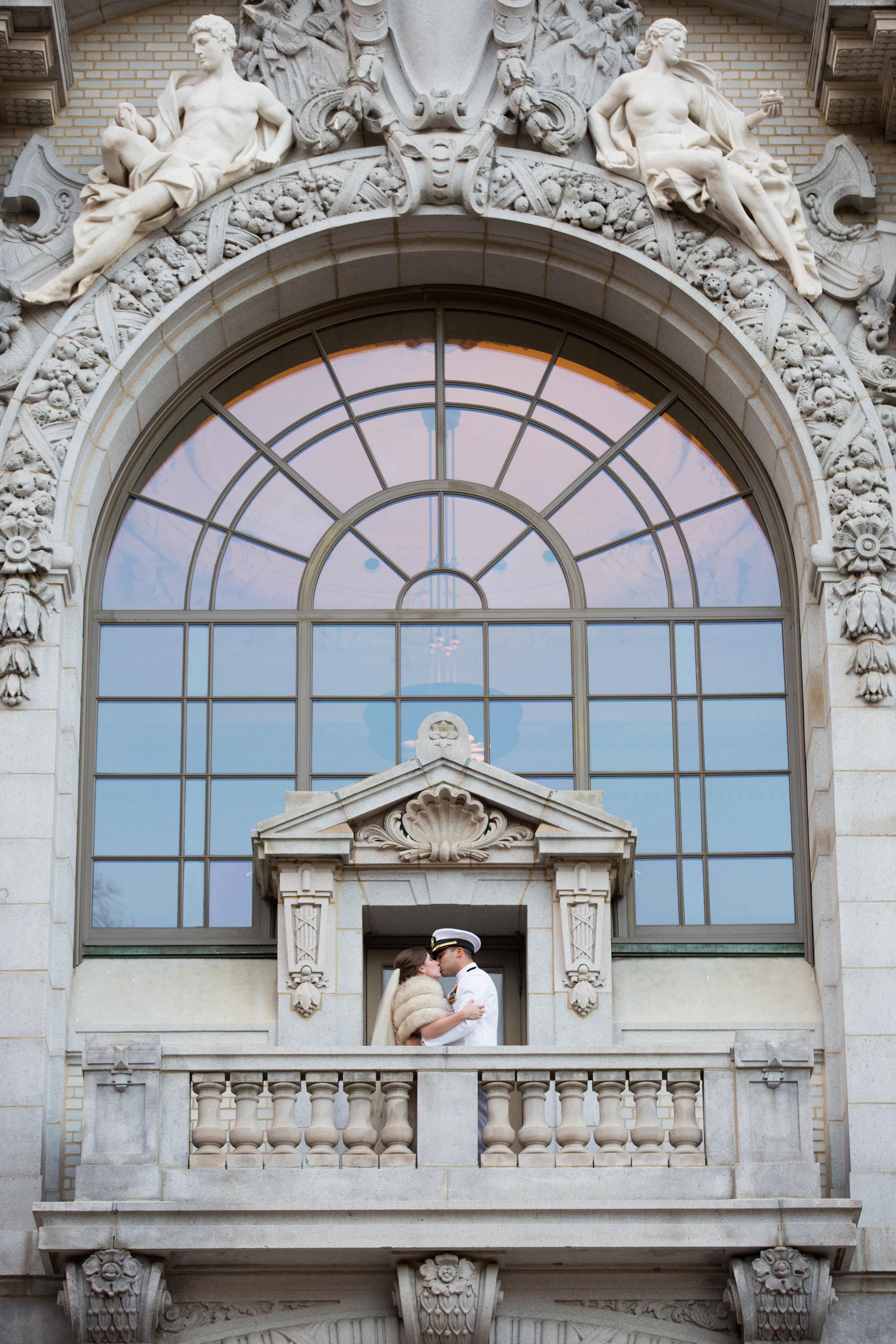 USNA wedding bride and groom on balcony