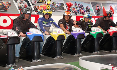 Bike Riders and Colour Helmets on the Superbike Racing  Simulator System For Hire