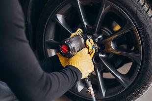 car-mechanic-changing-wheels-car.jpg