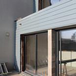 Maison neuve avec isolation et bardage James Hardie