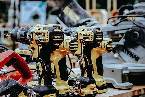 yellow-dewalt-hand-drills-on-table.jpg