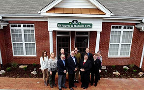 Rogers & Rudisill CPAs Staff in front of building