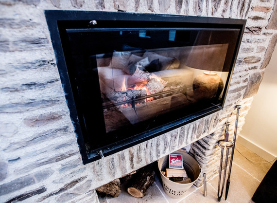 The feature fireplace was inset with a Stovax wood burner.