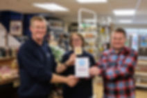 Stuart and Nicky Lowen receiving an award from Plastic Free Minehead