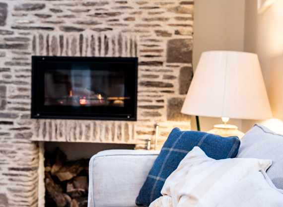 A feature fireplace was rebuilt using stone from collapsed walls within the property.