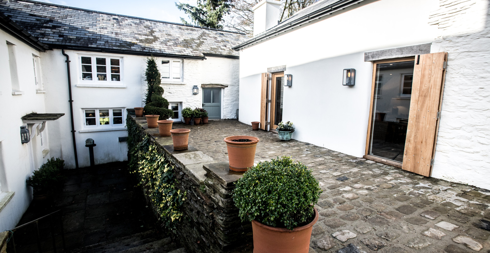 Outside we used reclaimed cobbles in the courtyard and the conversion of a redundant barn into a party barn!