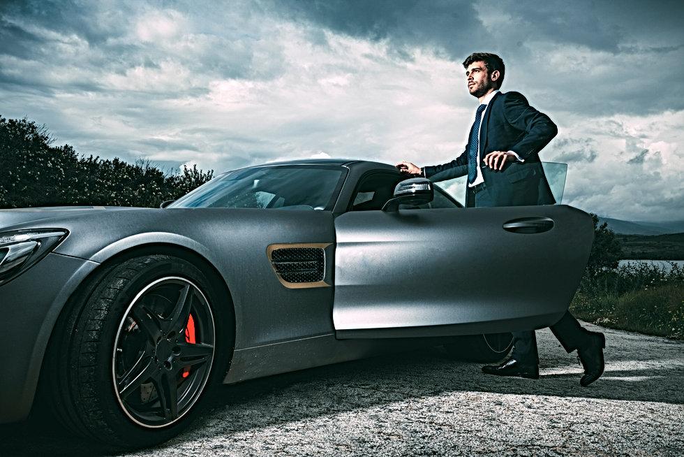 Business man in luxury car.jpg