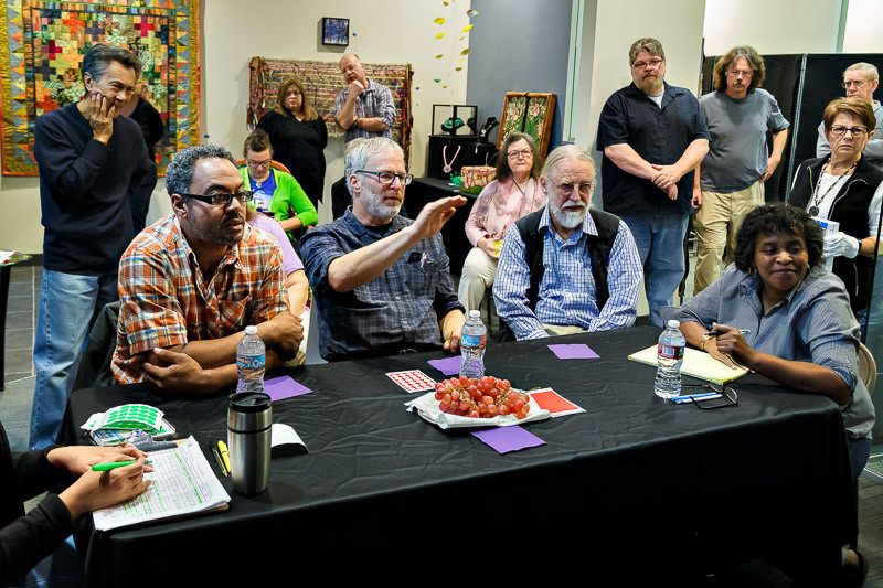 Jurors speak about their choices during the judging of the finalists in the color photography category.
