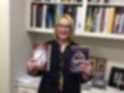 Betty Burkhalter with books.jpg