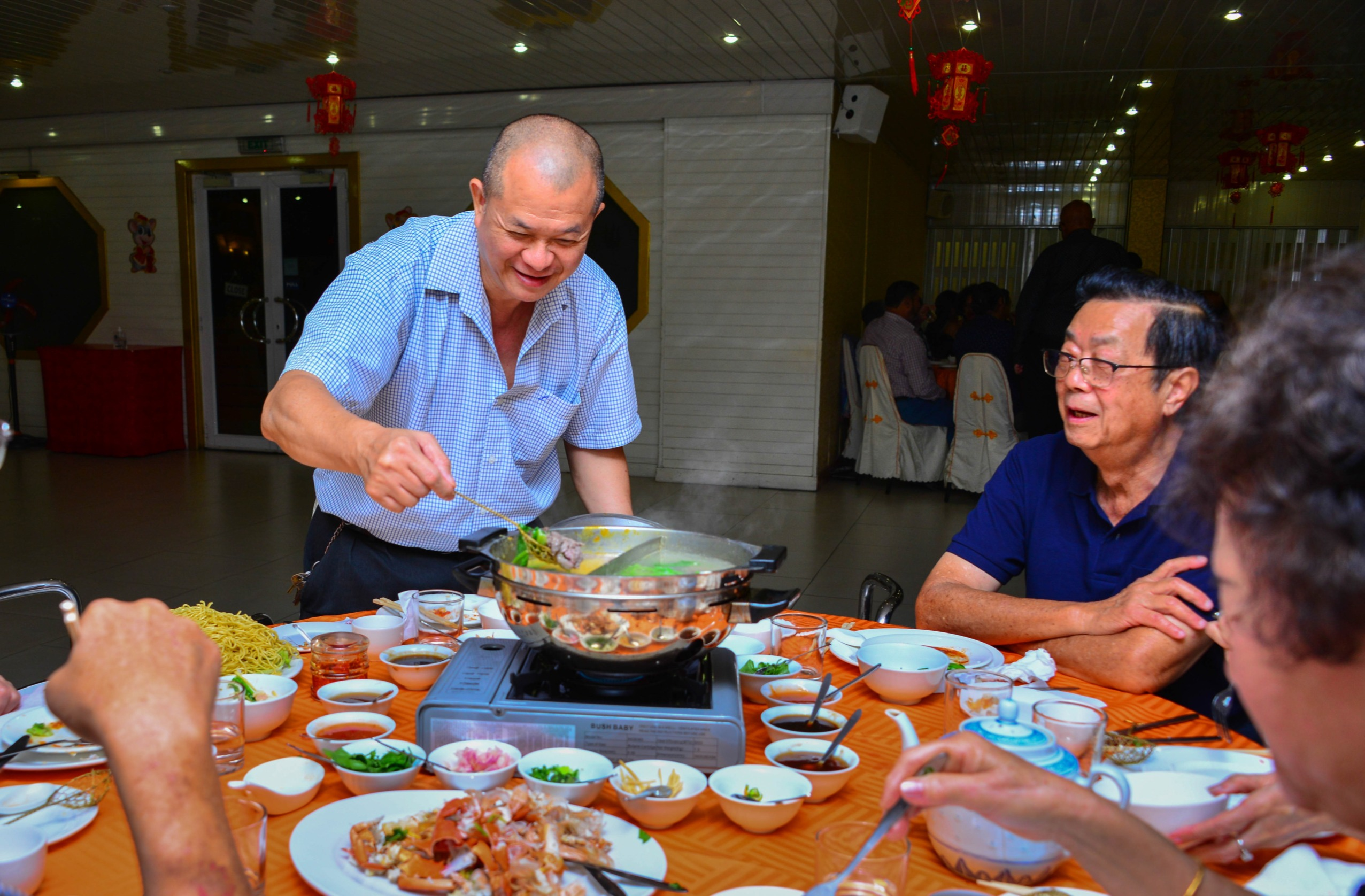 Happy clients eating Ying-Yang Steamed Boat