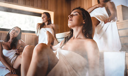 People relaxing in the sauna female frie