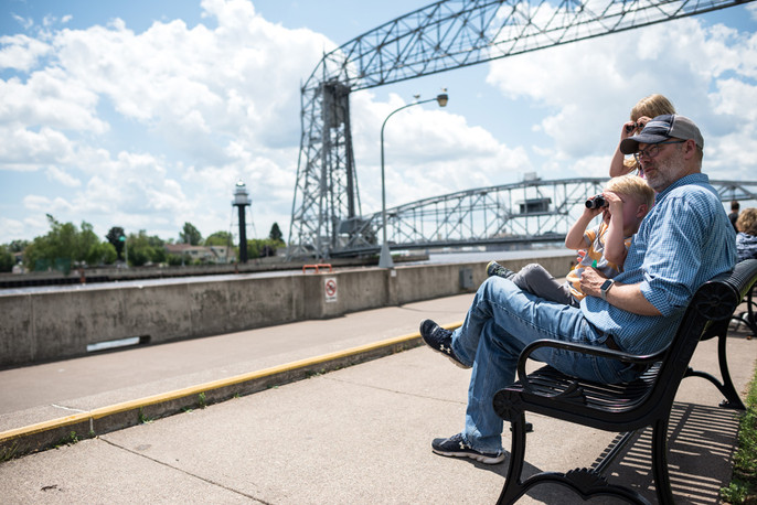 Family Watches Lakers Approach Aerial Lift Bridge
