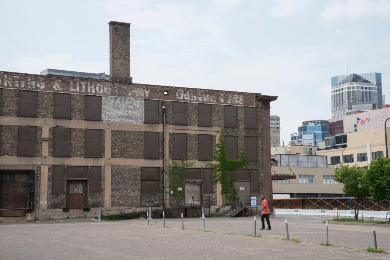 Empty Star Tribune Lot with Pedestrian