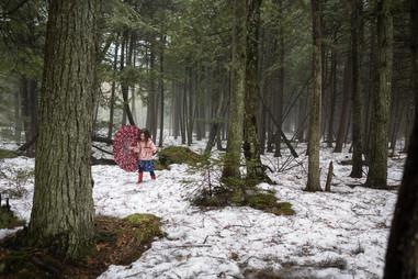 Girl Explores a Wet Wisconsin Northwoods